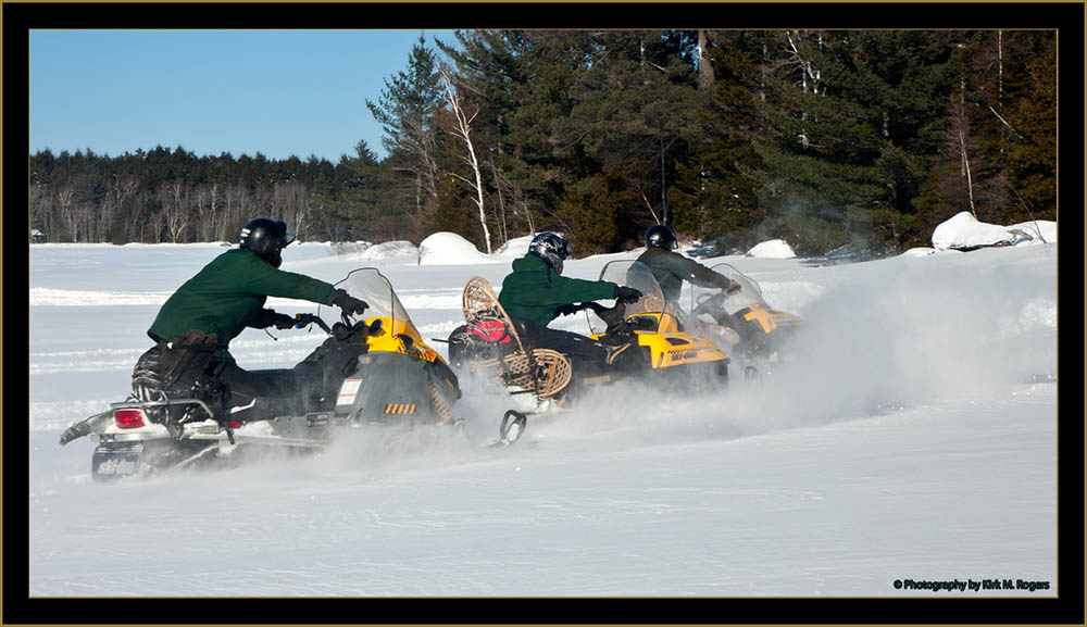 The Crew on Snowmobiles