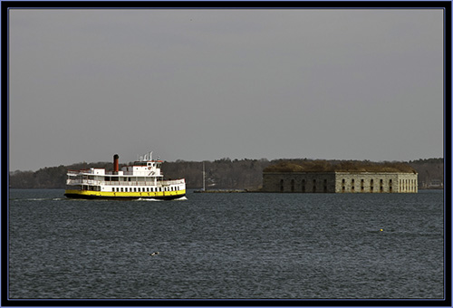 Ferry passing Fort Gorges from Portland Breakwater Lighthouse - South Portland, Maine